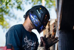 guy welding image